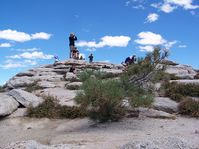 Lots of people at the top, relaxing and enjoying the incredible view.