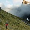 Rachel sidling above Gills Biv, Sentinel Peak above