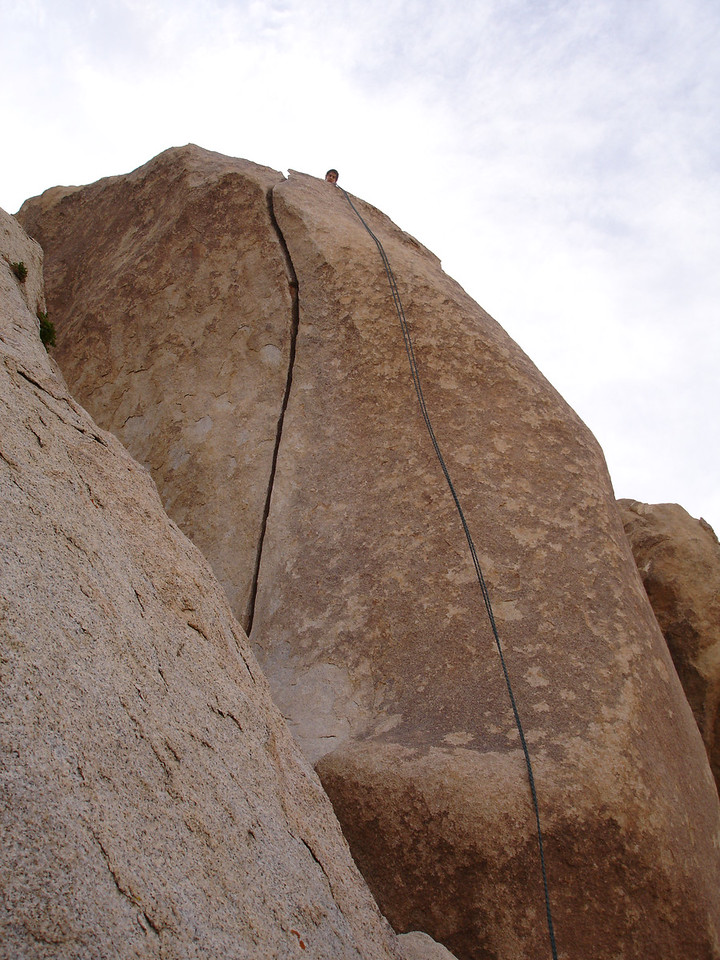 Marty setting up a top rope on Fisticuffs (5.10b), Real Hidden Valley, Tumbling Rainbow Formation.