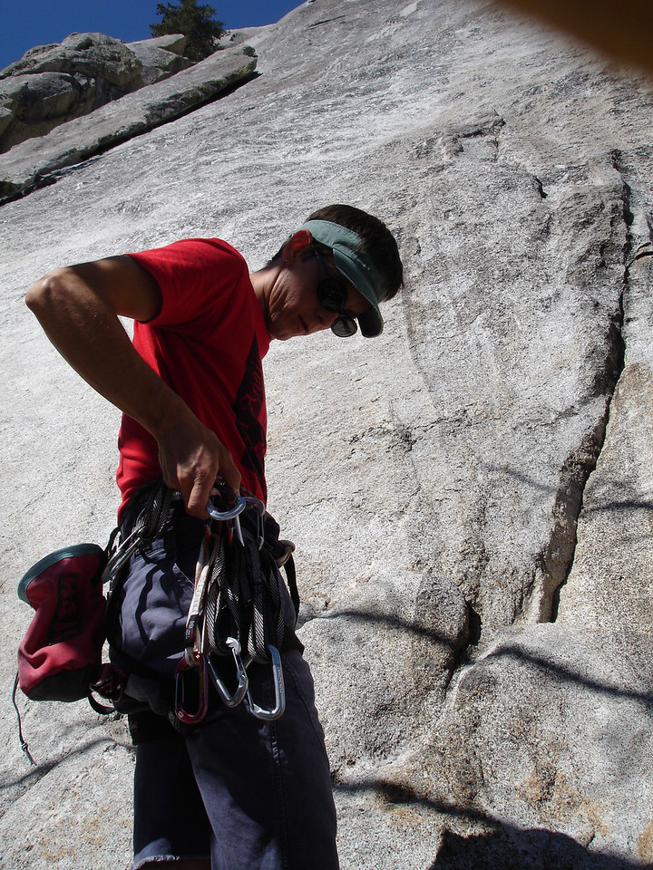 Marty checking his rack before starting out on Serpentine 5.9, Weeping Wall, Suicide Rock.