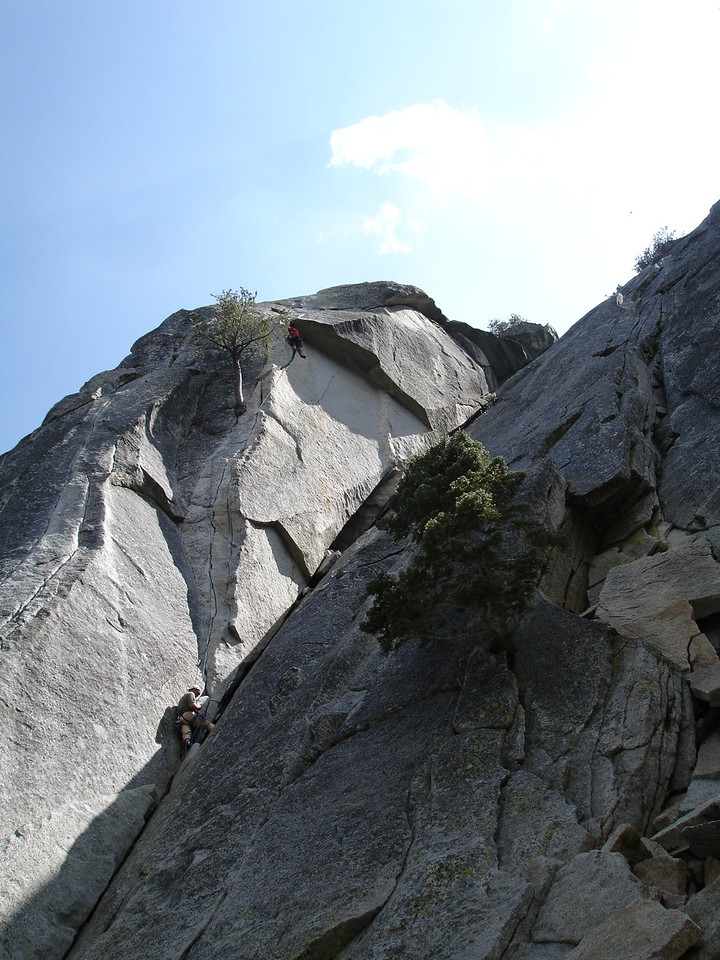Marty reaches the roof of Flower of High Rank 5.9. Rick is belaying. Suicide Rock.