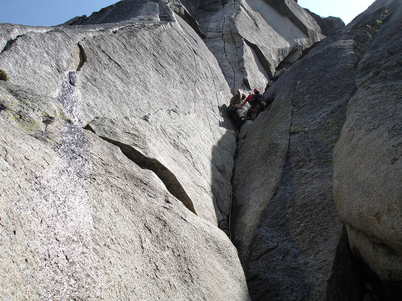 Marty and Rick setting up to do Flower of High Rank 5.9 the steep, wavy crack directly above them. Suicide Rock.