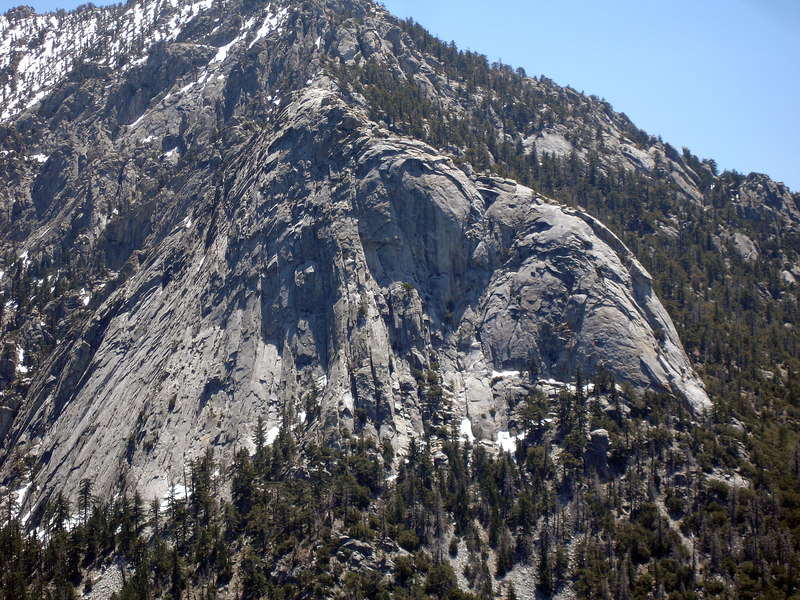 Tahquitz Rock from Suicide Rock. Snow is visible at the base as well as the upper north slope of the peak.