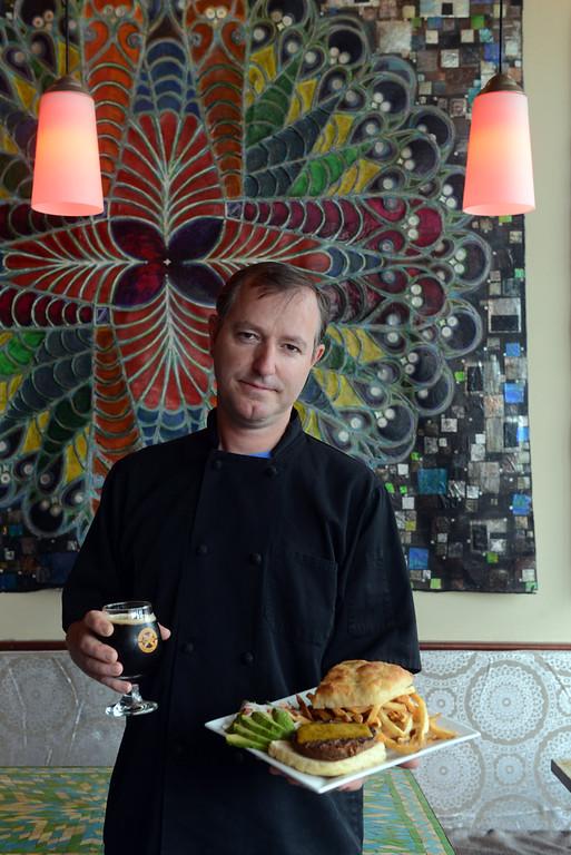 . Tania Barricklo-Daily Freeman    Rock Da Casbah chef Cody Ritson holds out the restaurant\'s signature veggie burger.