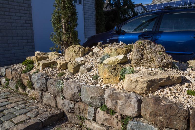 Raised bed with limestone and tufa rocks
