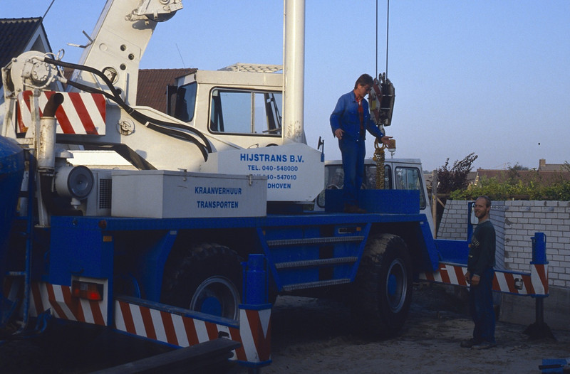 A crane is needed to move the concrete roof slabs.