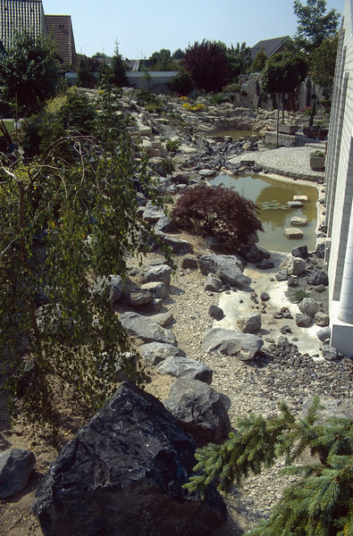 rainwater pipe coming from the roof of the house, East - West view (  construction rockgarden 1993)