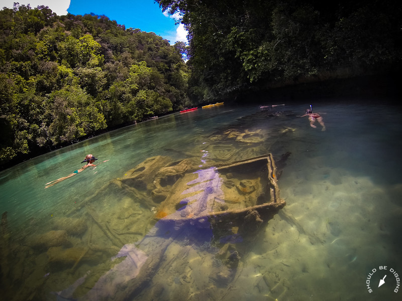 Snorkeling around a shipwreck in a shallow lagoon