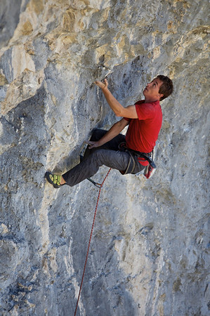 """Ross Suchy entering the crux of """"the dark side of the boom"""" 5.12a"""