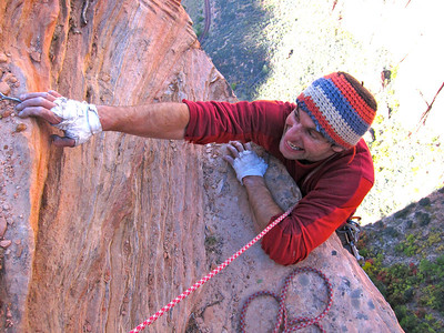 "A typical top out in Zion, reaching the rim on ""Shunes Buttres"""