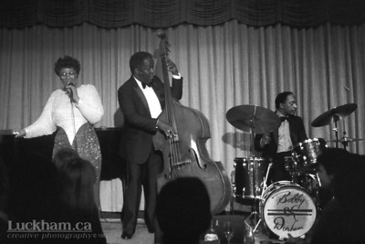 Ella Fitzgerald  Vancouver's Plazazz Showroom, December 9th 1983. Ella Fitzgerald, Keter Betts and Bobby Durham (not pictured Paul Smith on piano).