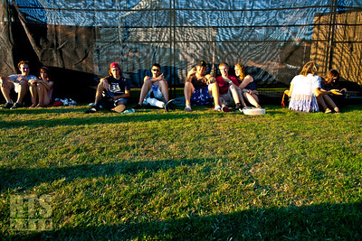 Tired concertgoers taking a rest Dan Shugar photo (c) 2013 www.danshugar.com