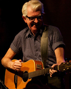 "Nick Lowe having as much fun as the audience (and we were having a lot of fun). And he played ""I Knew the Bride (When She Used to Rock 'n' Roll)"" which made everybody very happy. It would have been great seeing him plug in with a full band, but he's such an appealing performer and his songs so good that it didn't matter. (And the same went for the night's other singer/songwriter/guitarists.)"