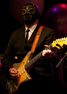 The volume cranked up when Los Straitjackets (Eddie Angel pictured) took the stage for a short set of instrumental gems before bringing earlier performers back onstage to sing with them.
