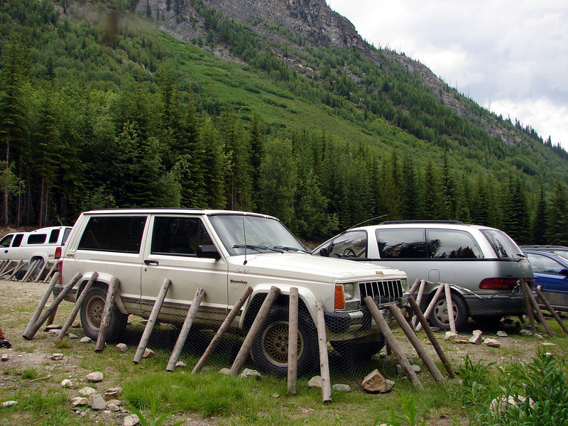 """The Jeep, all critter-proofed (porcupines and other wee beasties apparently like to nibble on rubber and brake linings and other car parts, so all of the vehicles in the parking lot were encircled by chicken wire, held at the top by the logs, and at the base by rocks). <br> Photo by <a href=""""http://shogun.smugmug.com"""">Alex</a>"""