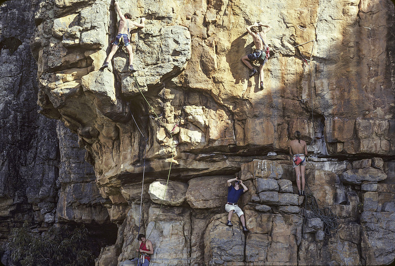 1980. This great photograph (above) by US climber Peter von Gaza shows Jeff Lamb having pulled over the overhang on Black Spasm (on the left) and Jon Muir on the crux of Grand Central (on the right). Mark Moorhead is belaying Jon but I can't remember who it was belaying Jeff. I'm in the middle, perched on the ledge and shooting images with my Olympus OM1n. I must have been fairly comfortable as I'm not even tied in. The following 3 photos were all taken by me at just about the same time as this one was shot.