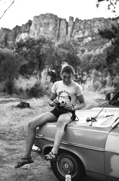 1980. Mark Moorhead sitting on the bonnet of Rod Young's Holden at Mt Arapiles.
