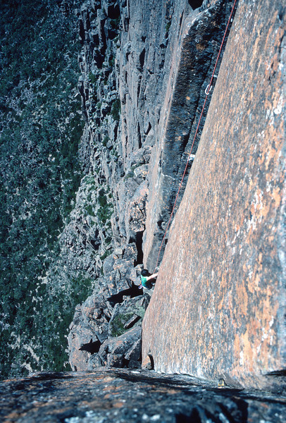 1983. February. Russ Clune (US) seconding Gates of Eden (18+). The Acropolis North Face. Lake St Clair, Tasmania.