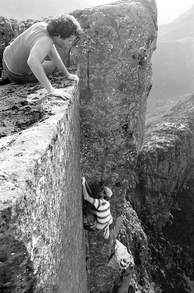 1983. February. Glenn Tempest leading on the first ascent of Black Man's Country (25). The Acropolis North Face. Lake St Clair, Tasmania.