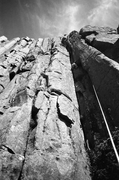 1983. February. Glenn Tempest leading on the first ascent of Old Wave Heroes (21). The Acropolis North Face. Lake St Clair, Tasmania.