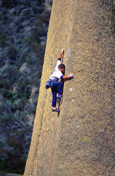 Malcolm Matheson on his spectacular arete of Shifting Sands (28). The Cathedral, Mt Buffalo, Victoria, Australia.