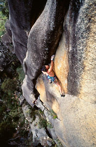 Malcolm Matheson on the first ascent (in 1994) of The Great Shark Hunt (30), perhaps the hardest pure crack climb in Australia. Mount Buffalo, Victoria.