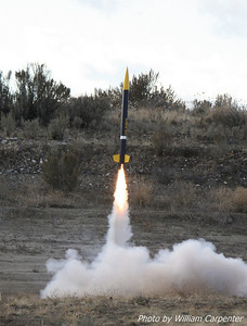 "A rocket named ""Blue Angel"", sporting a paint scheme to match, lifts off on a J90 long-burn motor."