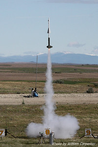 A scale Nike Hercules lifts off on a cluster of black powder motors.