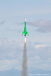 "Luke Carpenter's ""Green Machine"" (an Estes Interceptor E) lifts off on an F24."