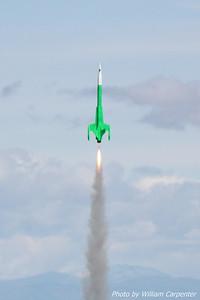 """Luke Carpenter's """"Green Machine"""" (an Estes Interceptor E) lifts off on an F24."""