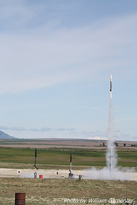 Ken Tsai's rocket is the first off the pad in a three way drag race.