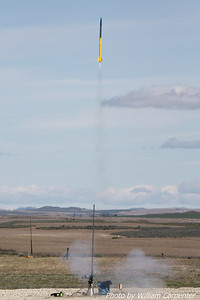 A Hybrid rocket lifts off from the high-power pads.