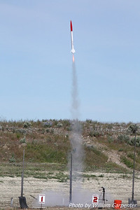 A scale ARCAS lifts off on a Cesaroni G54.