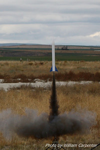 My Madcow Rocketry Solar Express lifts off on a Cesaroni F36.