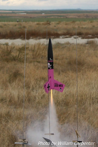 "An Estes ""Der Pink Max"" lifts off from the low-power pads."