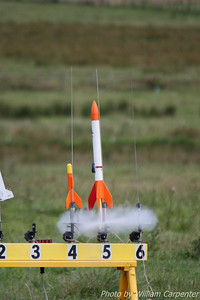 A low-power rocket carrying a key fob video camera lifts off.