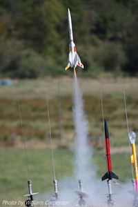 Andrew MacMillen's Estes ARV Condor lifts off carrying its two parasite gliders.