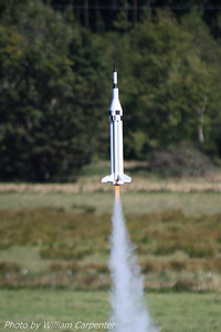 "A rocket named ""Tranquility Nine"" lifts off on a cluster of three B6s."