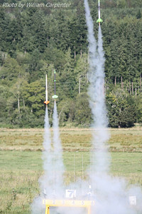 A four-rocket drag race launches from the model pads.