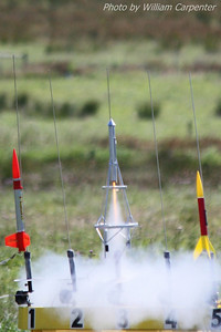 A Goddard-themed model rocket lifts off.
