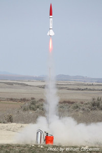 "My Madcow Rocketry 4"" Little John lifts off on an H148 for my Jr Level One certification flight."