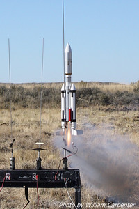 Tim Doll's Titan III lifts off on an E18 White Lightning motor.