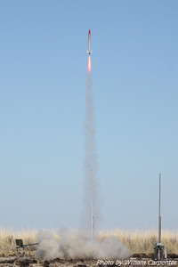 A rockets lifts off on a Redline motor for a level one certification flight.