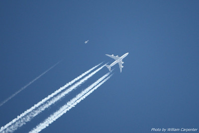 A test flight of Boeing's new 747-8 flew over the launch site, with what looks like a T-38 chase aircraft.