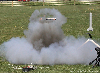 "An Art Applewhite X-Fire (pronounced ""cross fire"") lifting off on two E18s. In this photo, one motor has already broken free of the airframe, as has one wing."