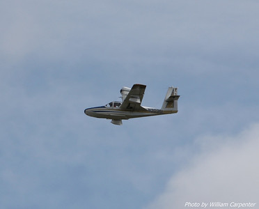 A rather interesting amphibious plane with a pusher prop flew over the launch site.