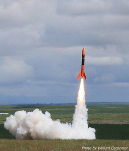 Carl Degner's 7.75x Upscaled Estes Alpha III lifts off from the keyhole for a Level Three certification flight.