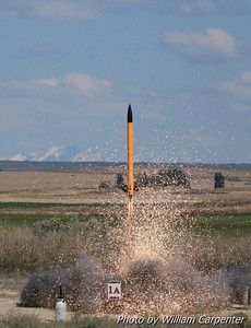 "A rocket lifts off on a K-impulse motor with AeroTech's new ""Dark Matter"" propellant."