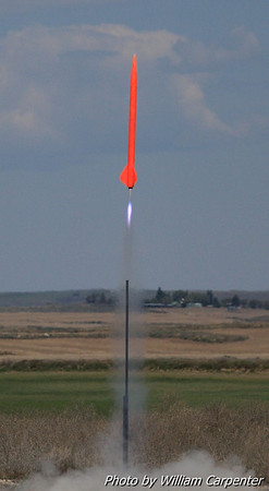 A very orange rocket lifts off on a Level One certification attempt.