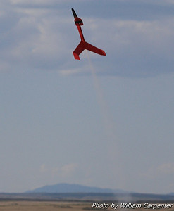 A boost glider lifting off from the model pads.